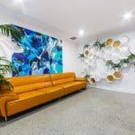 Orange lounge with concrete flooring and blue painting