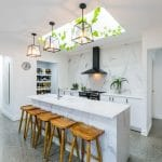Kitchen with marble backdrop and polished concrete floors