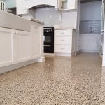 Beautiful white kitchen with polished concrete floors
